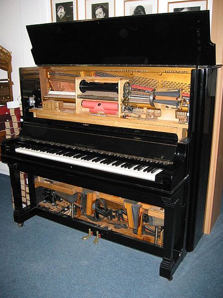 Mechanical piano players